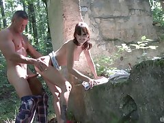 Brunette teen Suzi Rainbow bent over and pounded in the forest