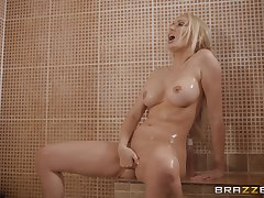 Blonde Amber Jayne takes a shower before a charge from in fishnet stockings