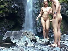 Erotic sex with young beautiful blonde outdoors near waterfall